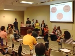 Physical therapy students use the Cup Song to teach new skill