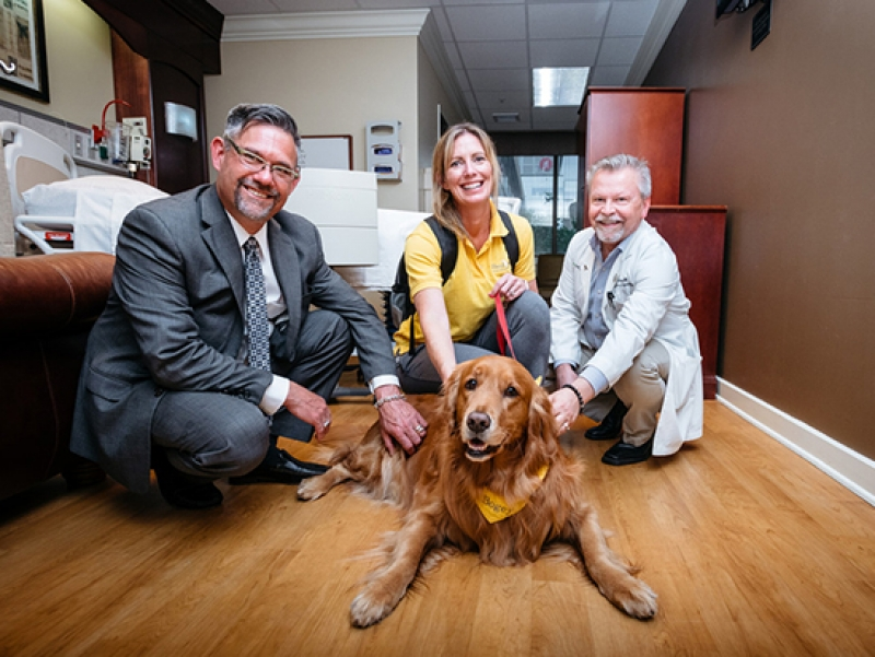 Young dog's legacy eliminates barriers to volunteering; brings joy to palliative care patients