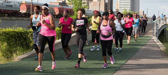 Olivia Affuso (center) and members of Black Girls Run Birmingham on an evening run at Railroad Park