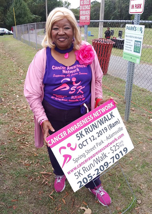 Breast cancer survivor and founder of the Cancer Awareness Network for Children, Loretta Herring promotes her organization at an event in 2019. (Photo submitted)
