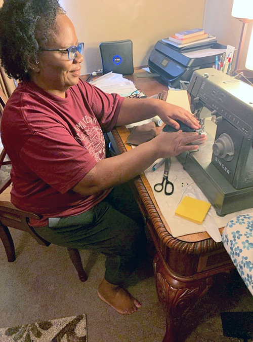 Margaree Ruffin sits at her sewing machine to prepare her latest batch of handmade face masks. (Photo submitted)