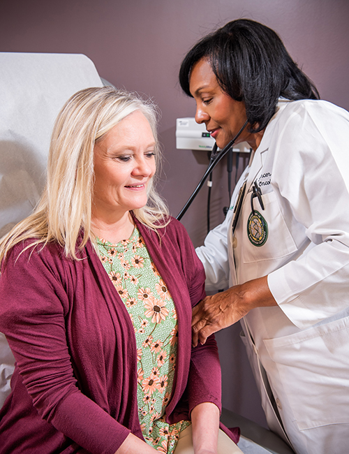 Sharon Spencer, M.D., UAB radiation oncologist and senior scientist in the O'Neal Comprehensive Cancer Center, treats a patient at UAB Hospital. (Photo courtesy of UAB Medicine)
