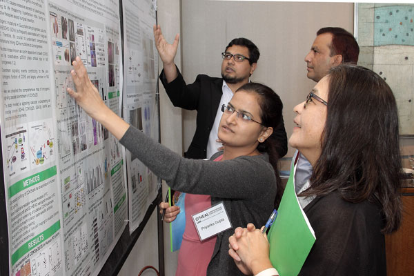 Researcher Explaining Poster 3