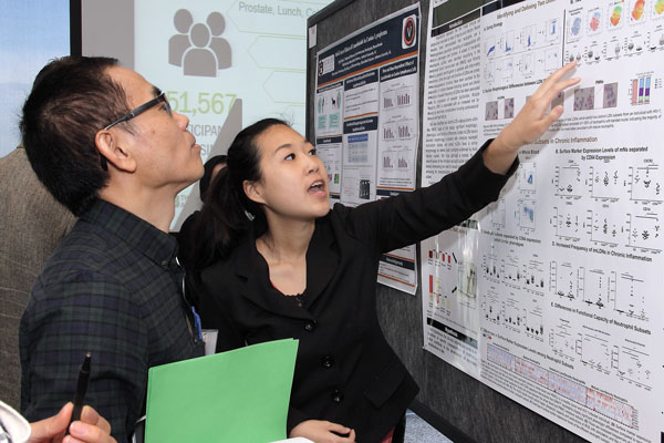 Researcher Explaining Poster 4