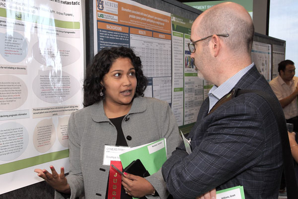 Researcher Explaining Poster 6