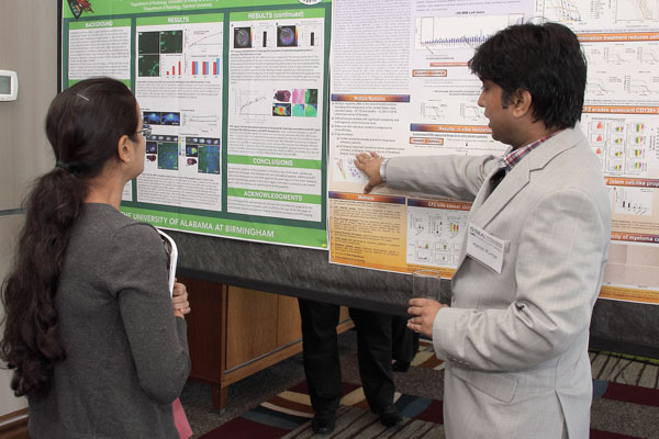 Researcher Explaining Poster 8