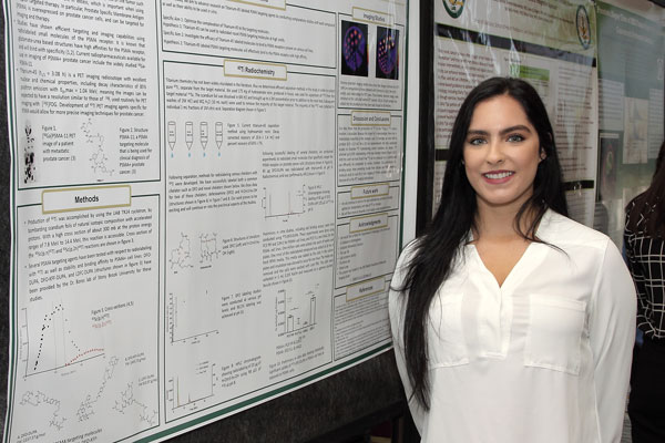 Researcher Posed With Poster