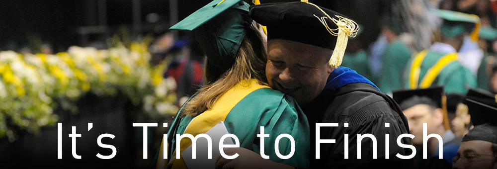 A faculty member hugs a UAB graduate