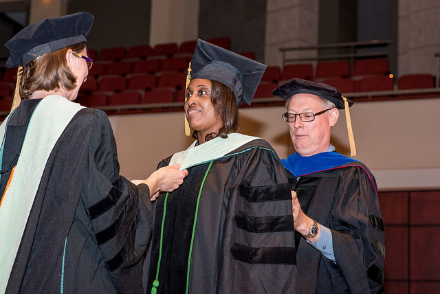 Carey Dillard being hooded at her Convocation and Hooding Ceremony