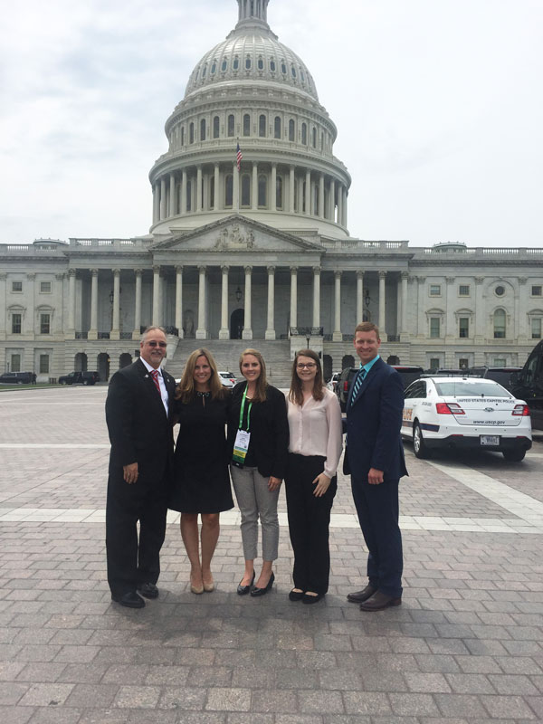 Lauren Boudousquie, Jessica Boyd, Samantha Elliott and Natalie West standing in front of Capitol Hill