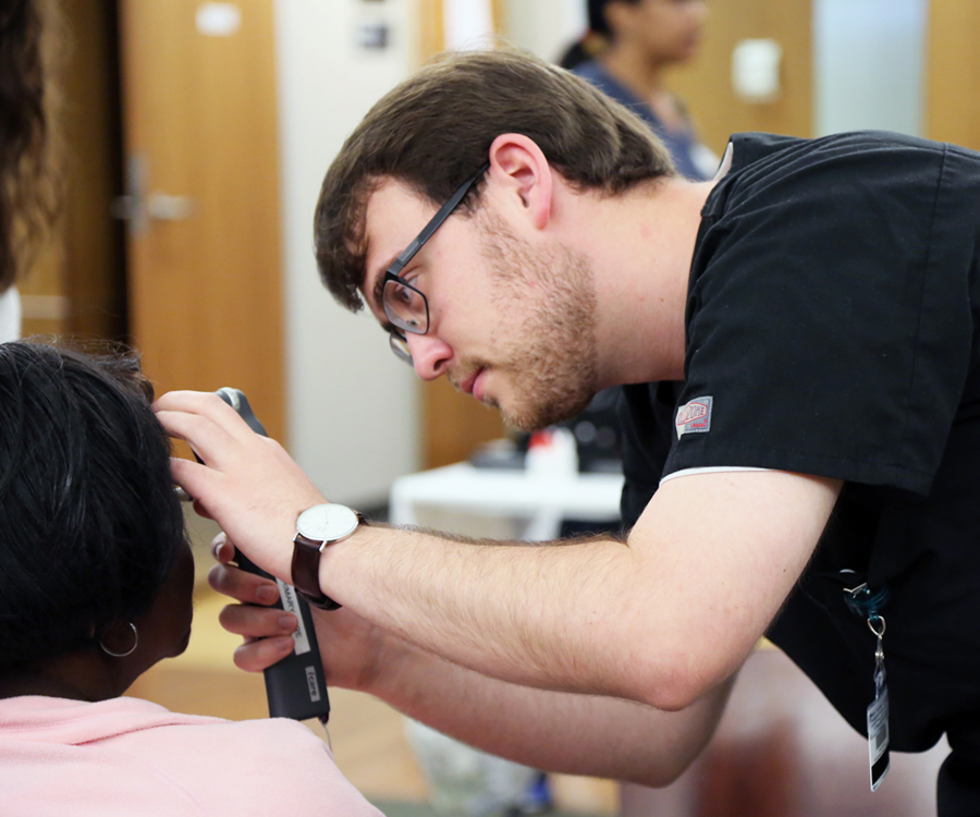 A student with the UAB School of Optometry examines a patient during the 2017 Gift of Sight event. Altogether, 260 patients received free eye care over four days.