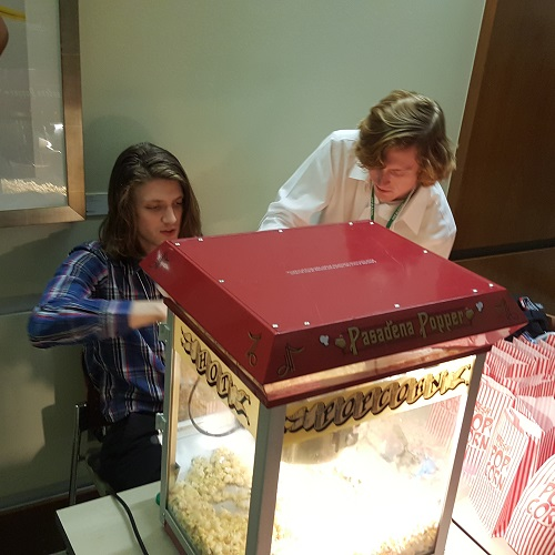 Outgoing graduate assistant Samuel Phillips and incoming graduate assistant Adam Higgins prepare popcorn for our screening of