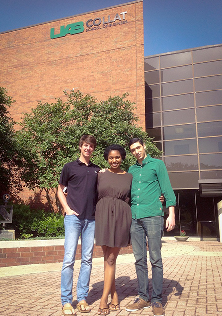 John Reichle, Jaala Shelwood, and Rami Elsharif stand outside the Collat School of Business.