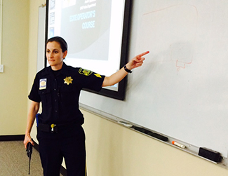 UAB Police Sgt. Amy Schreiner conducts violence response training.