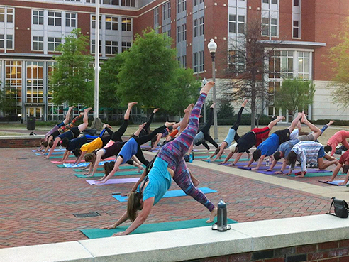 4. Practice yoga on the Campus Green.