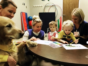 UAB pairs with Hand in Paw to make significant (and snuggly) impact in city classrooms