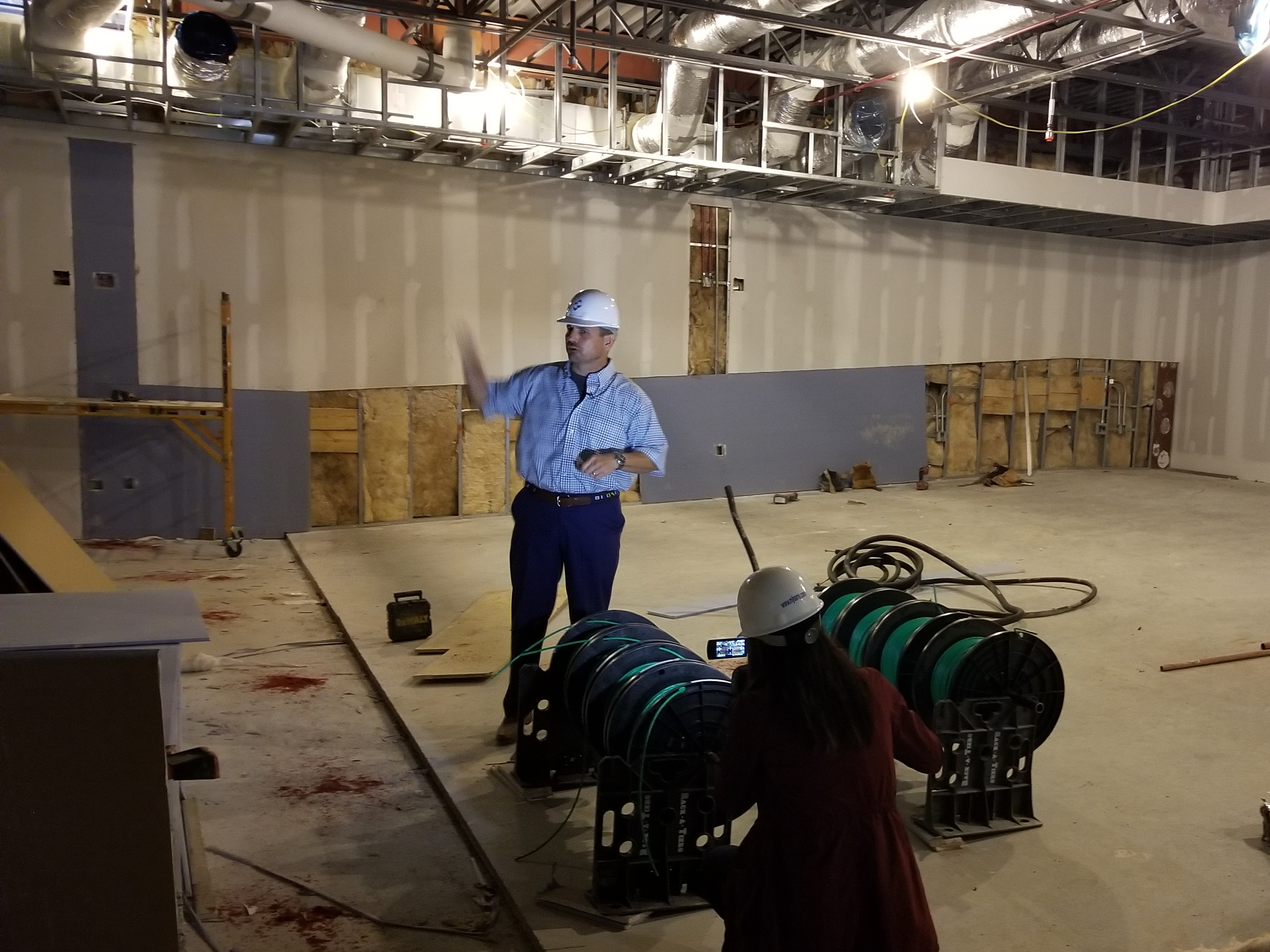 UAB Football Head Coach Bill Clark talks to the media while standing inside the new team meeting space which will feature theater style seating.