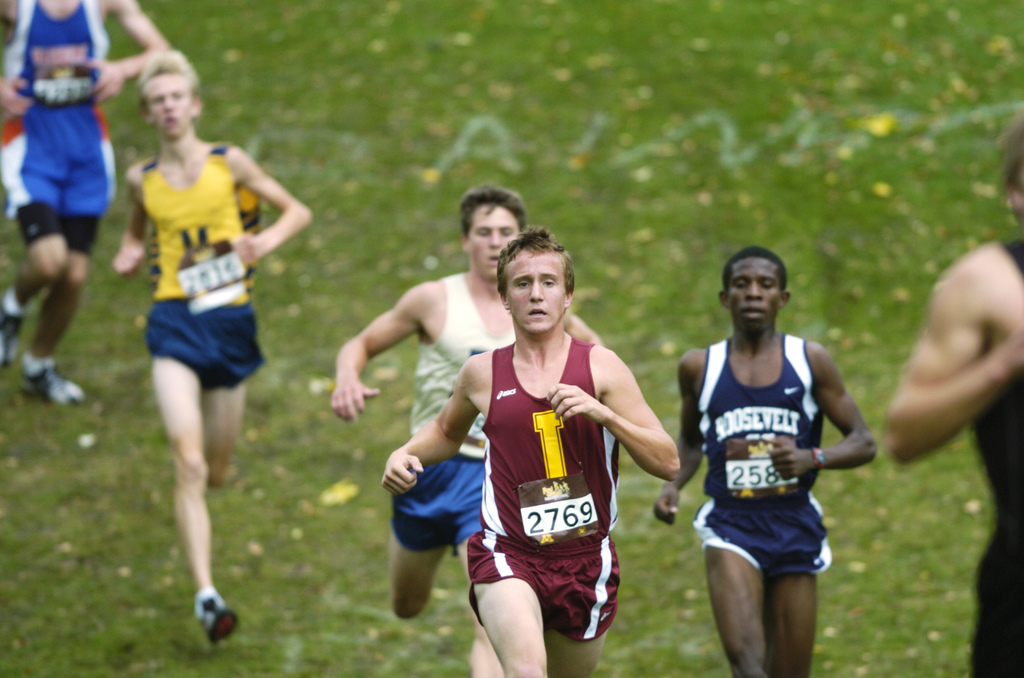 the sport of cross country running Cross country running takes place over varied surfaces under a variety of conditions during the autumn and winter, making stability a key attribute.
