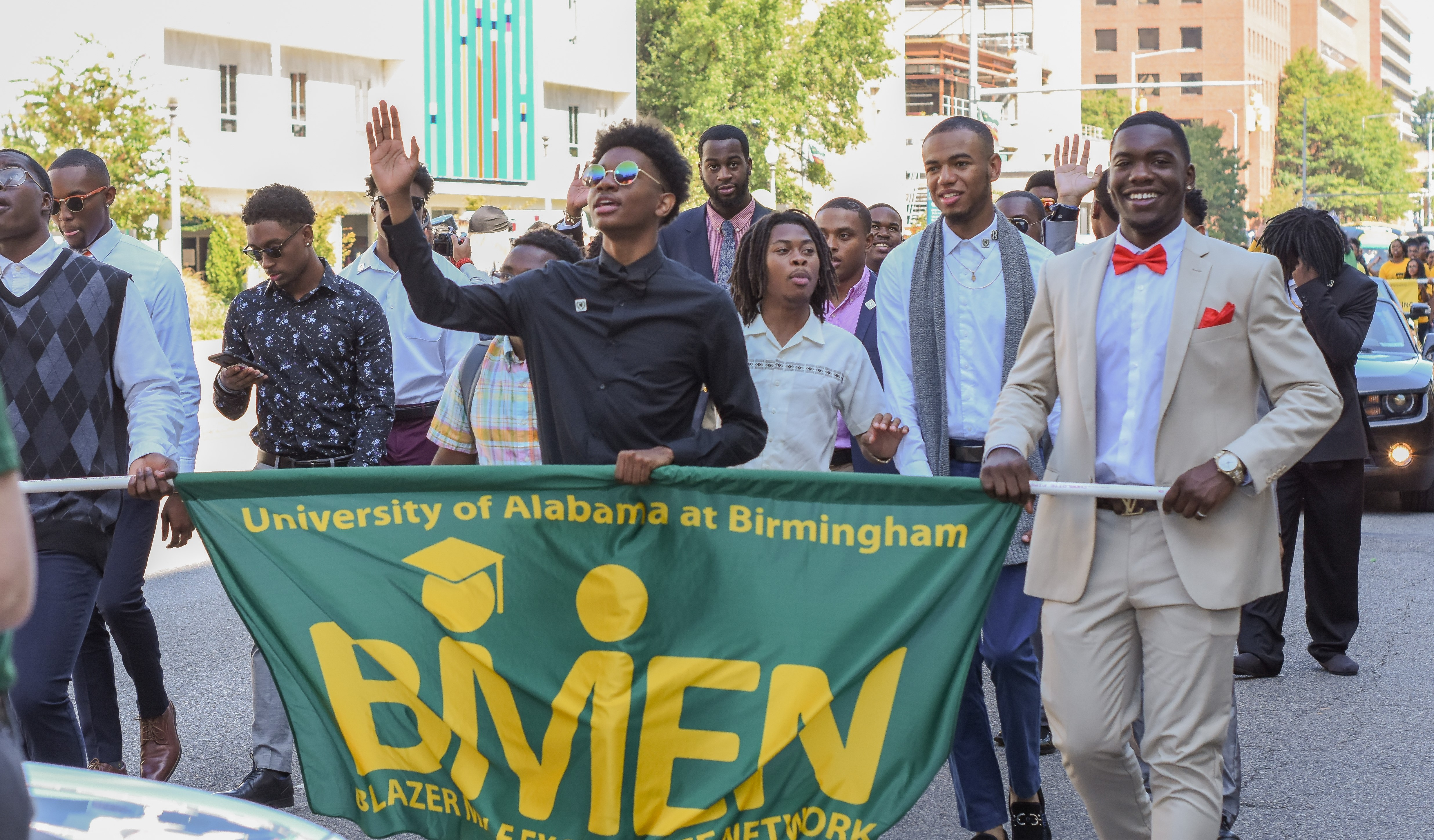 UAB BMen wave to the parade spectators.