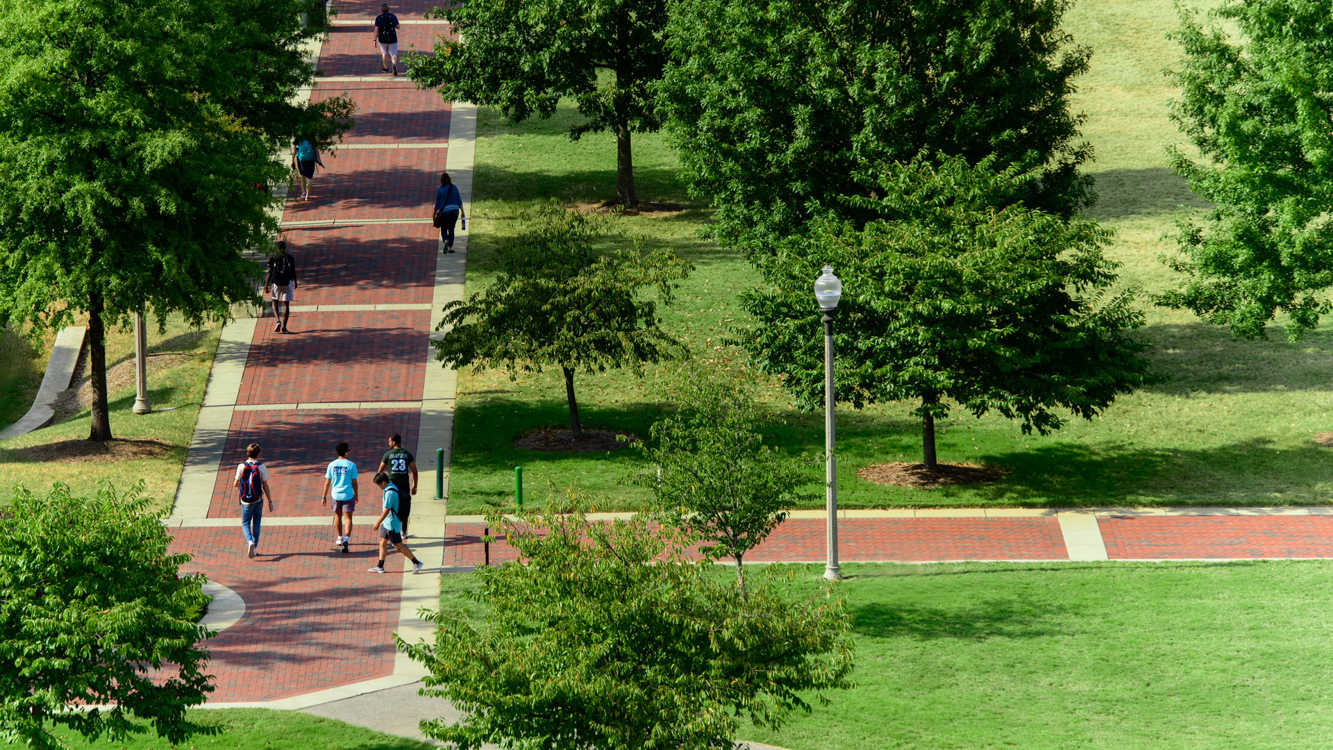 Students walking on the campus green.