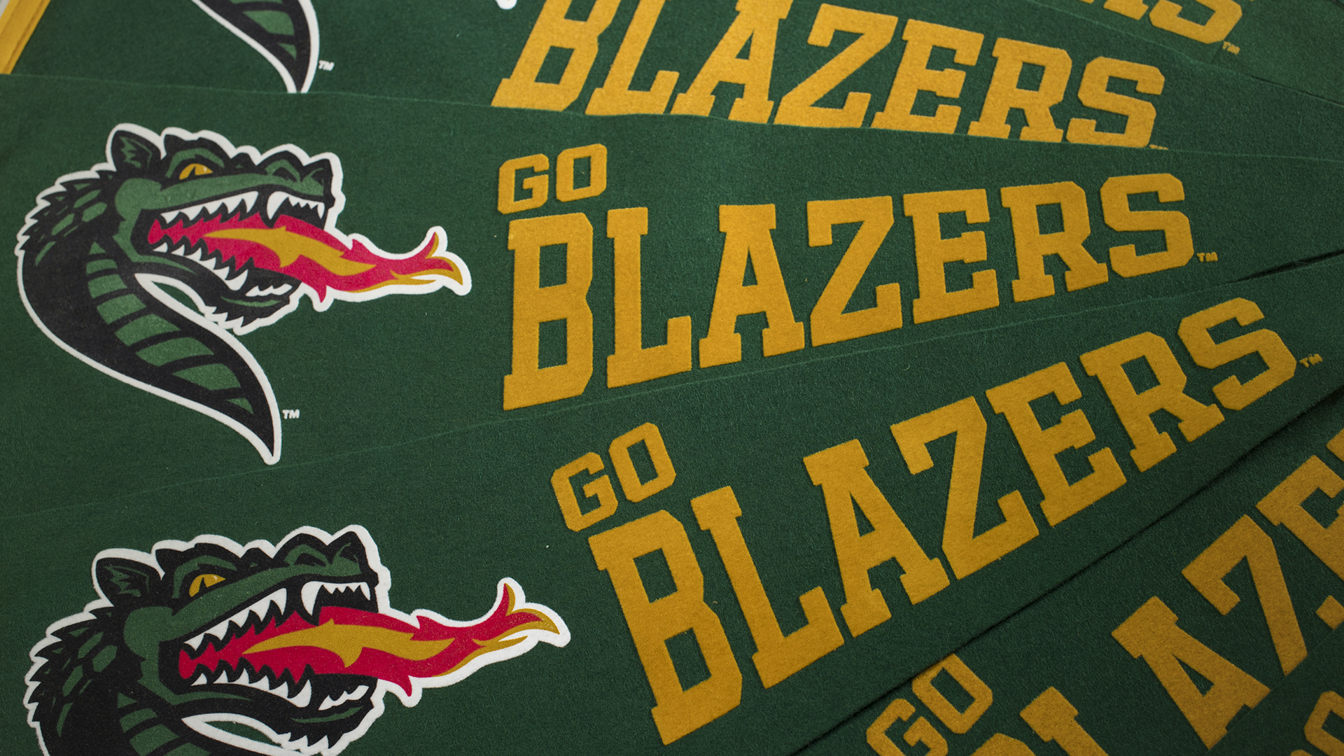 Blaze pennants with 'Go Blazers' in gold text.