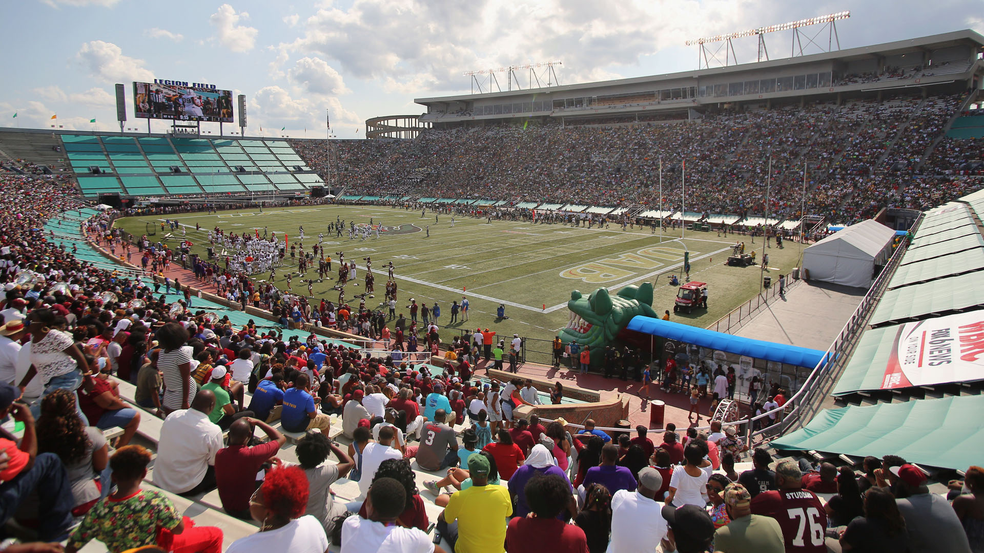 Legion field with crowd in the stands watching a football game.
