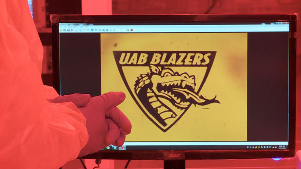Photo of UAB Blazers shield on lab computer screen