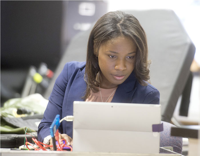 Photo of Ophelia Johnson working on computer
