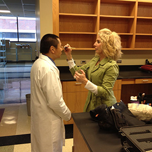 UAB scientist in makeup before brand video shoot