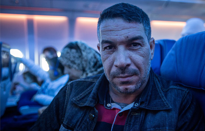 Photo of Syrian refugee on airplane