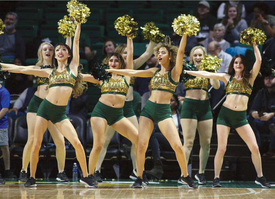 Photo of Golden Girls dancing at basketball game