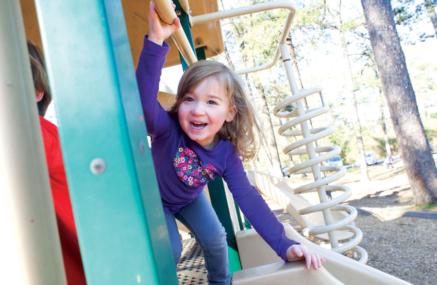 Photo of little girl on playground