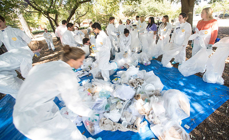 Photo of students sorting trash