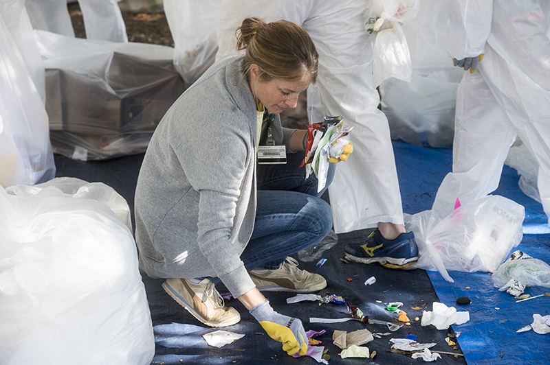 Photo of Julie Price sorting trash among students
