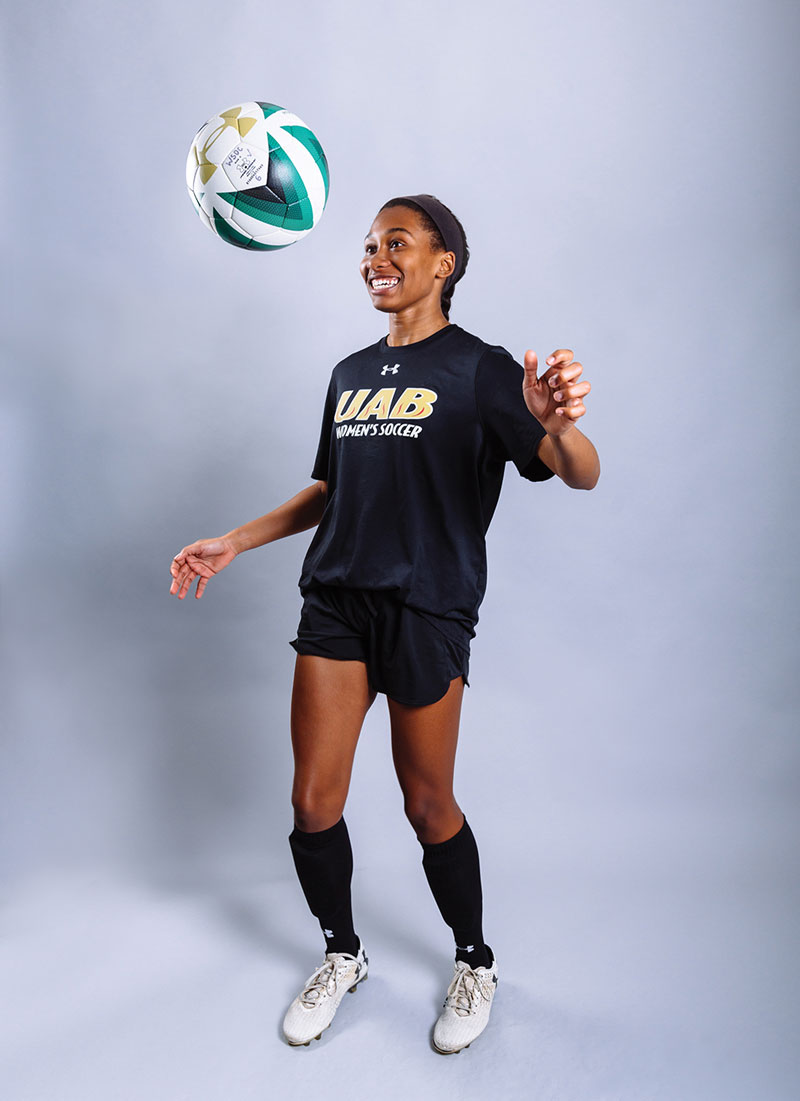 Photo of student Audria Wood bouncing soccer ball