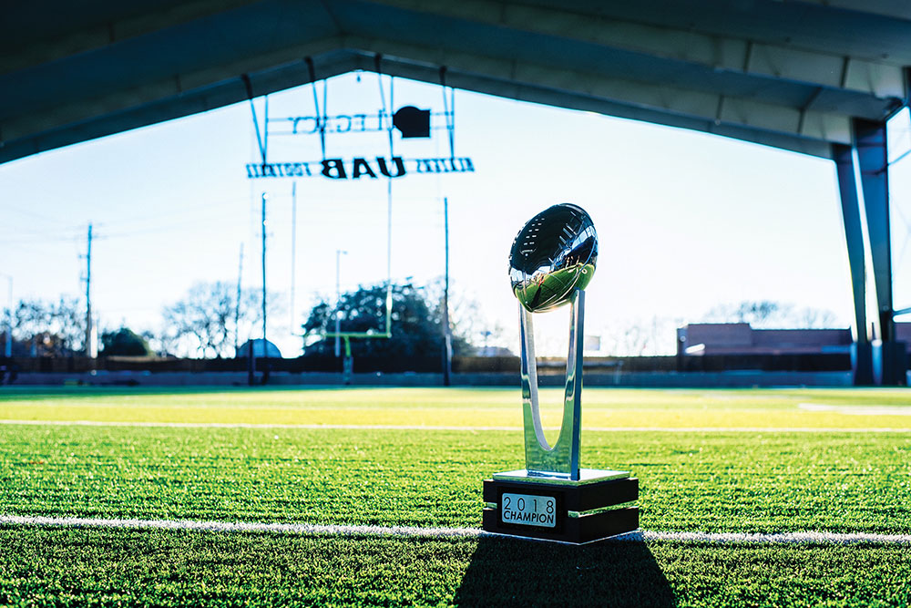 Photo of Conference USA trophy on Legacy Pavilion field