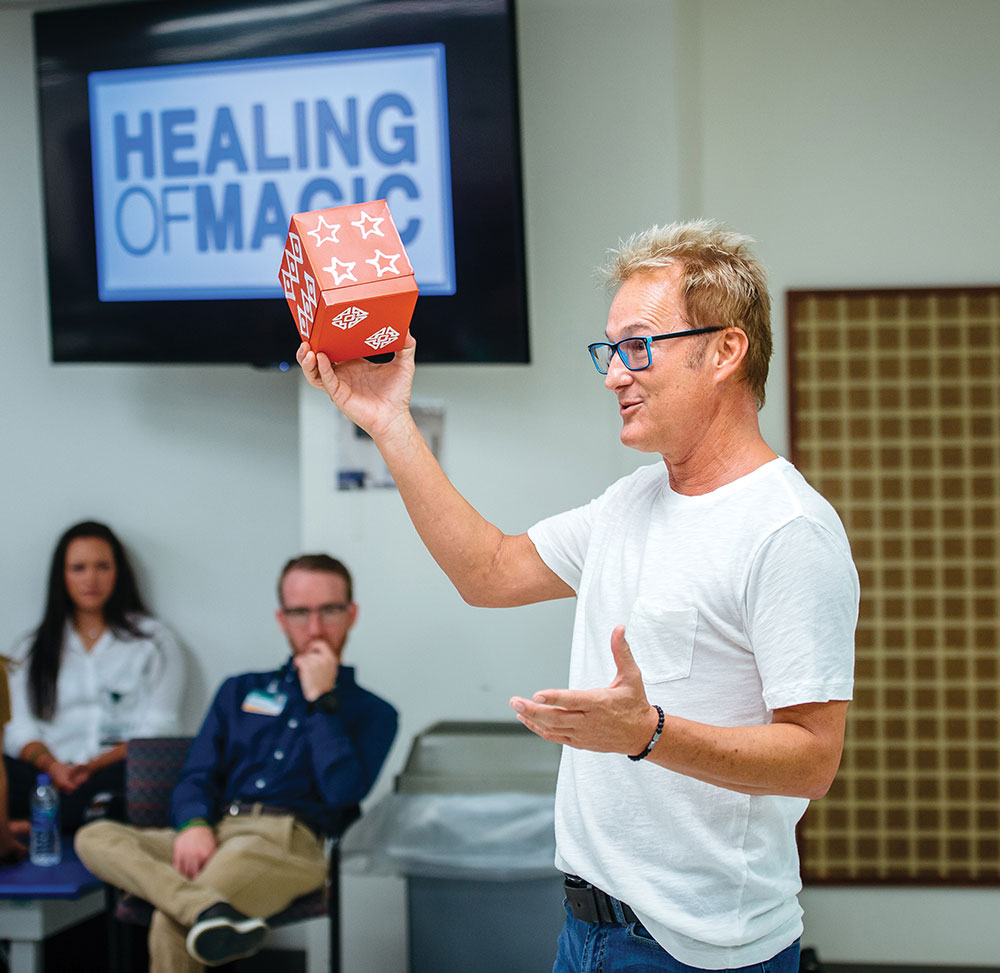 Photo of Kevin Spencer demonstrating magic trick for occupational therapy students