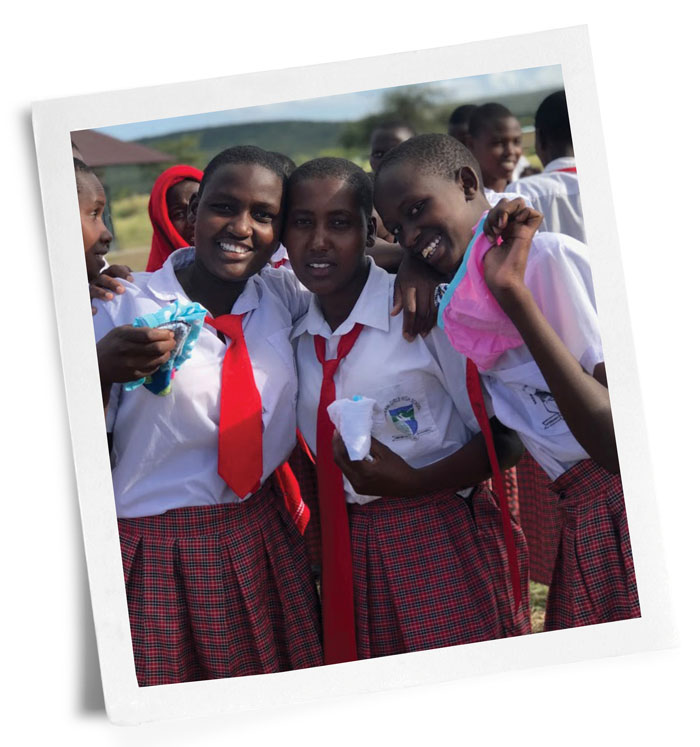 Photo of Kenyan girls with donated sanitary supplies