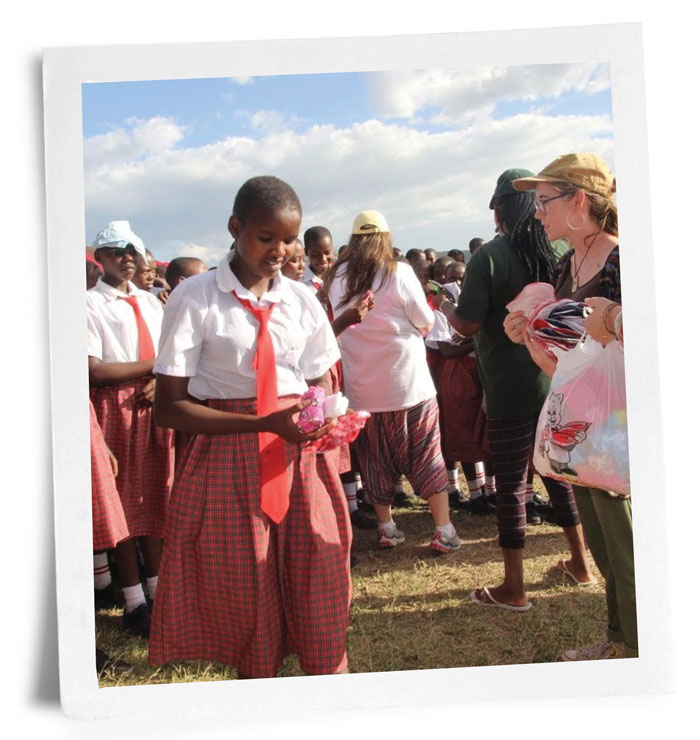 Photo of Kenyan girls receiving sanitary supplies from UAB students