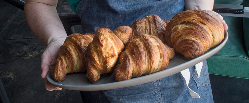 Closeup photo of croissants held by Kristen Farmer Hall