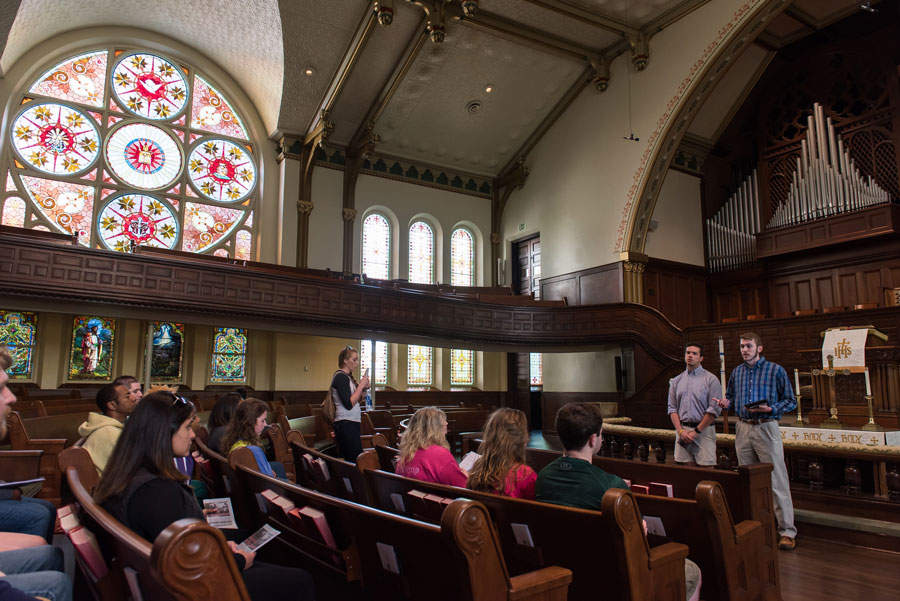Photo of tour leaders talking to group inside First Methodist Church