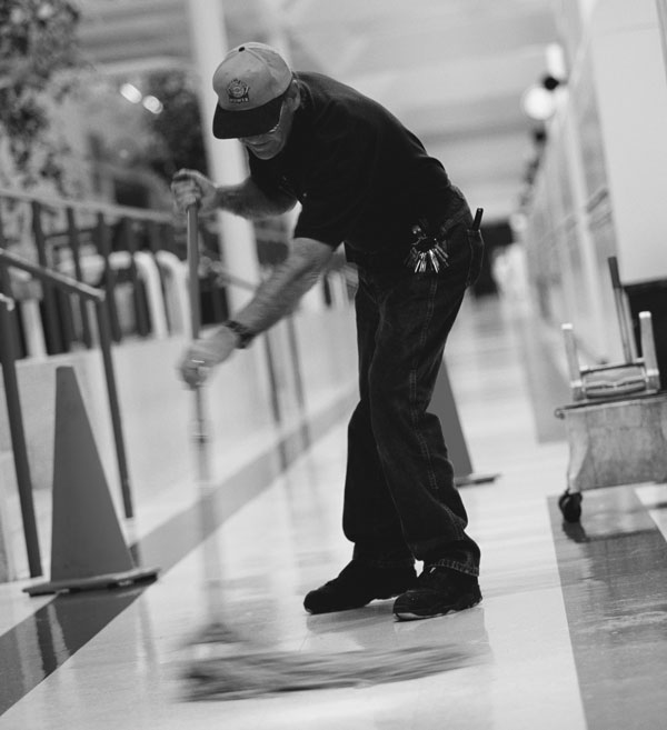 Photo of man mopping floor