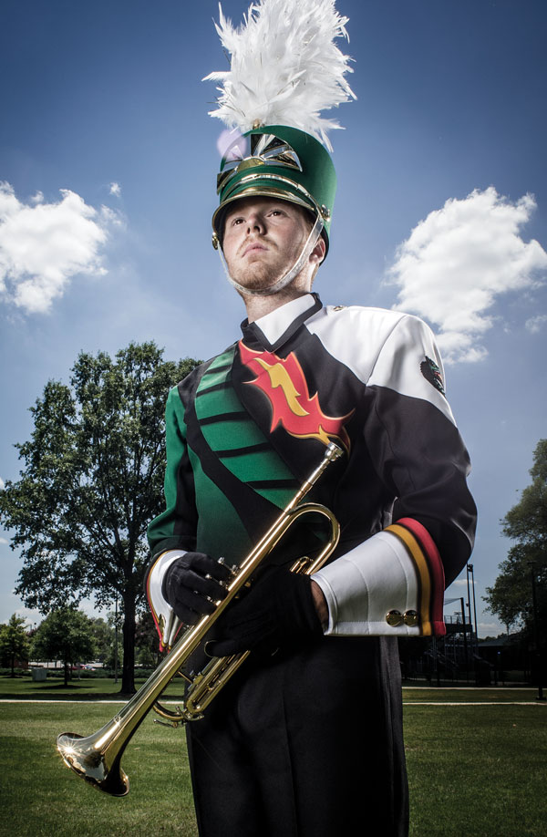 Photo of student wearing new band uniform and holding trumpet