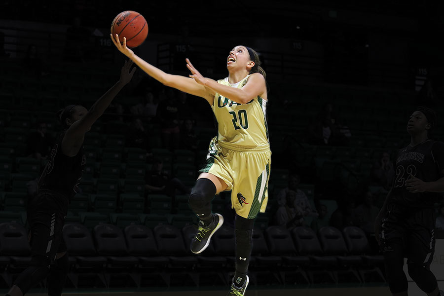 Photo of player Rachael Childress jumping toward the goal during a Bartow Arena game