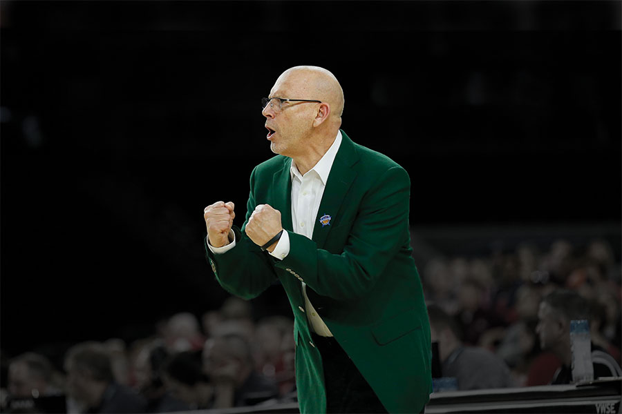 Photo of Coach Randy Norton cheering on team at Bartow Arena game