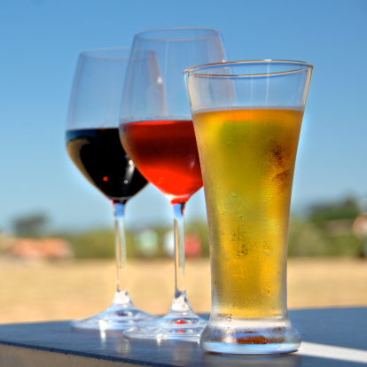 Photo of full wine and beer glasses