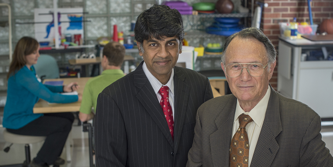 Gitendra Uswatte and Edward Taub in UAB's CI Therapy facility