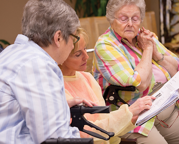 Lillian Mitchell consults with geriatric dental patients on their care.