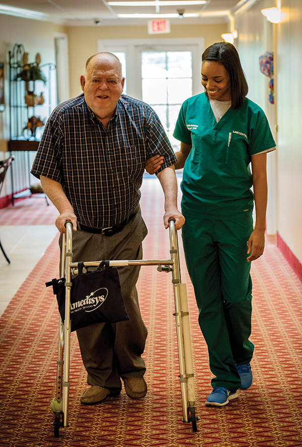 Dental student D'Andrea Nekelle Holmes walks with a Fair Haven resident.