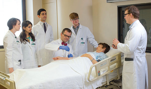 Photo of students and Younger with patient